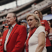 University of Houston donor, Welcome Wilson Sr., watches the game from the stands with his family.<br /> <br /> Todd Spoth for The New York Times.