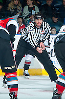 KELOWNA, CANADA - NOVEMBER 11: Linesman Chad Huseby prepares to drop the puck between the Kelowna Rockets and the Vancouver Giants on November 11, 2015 at Prospera Place in Kelowna, British Columbia, Canada.  (Photo by Marissa Baecker/ShoottheBreeze)  *** Local Caption *** Chad Huseby; Linesman;