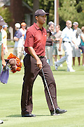 Jul 31, 2005; Grand Blanc, MI, USA; Tiger Woods walks to the third green during final round play at the 2005 Buick Open at the Warwick Hills Golf and Country Club. Copyright © 2005 Kevin Johnston