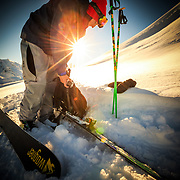 Tyler Hatcher skins up for another run in the Cascade backcountry in early morning light while mounting a GoPro Hero 3.