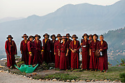 15th May 2010, Ramkot: Nuns sstand for a portrait as they tend the gardens at the Druk Gawa Khilwa Buddhist Nunnery, Druk Amitabha Mountain, Ramkot, near Kathmandu, Nepal, 15th May 2010.<br /> <br /> The nunnery founder, his Holiness the present Gyalwang Drukpa instigated Shaolin Kung Fu training for his nuns in 2010 after a visit to Vietnam where he witnessed Vietnamese nuns practicing the martial art. He was told that it helped the Vietnamese nuns concentrate better and made them more self-reliant and recalling how some of his nuns at the Khilwa nunnery were fearful of travelling down from the mountain alone he decided to incorporate defensive Kung Fu training at his own nunnery. Only nuns under 25 are taught due to the physical challenges and there are currently 3 sessions a daystarting in the early morning. The Kung Fu training has energised the nuns and made them fitter, more self confident and alert.<br /> <br /> PHOTOGRAPH BY AND COPYRIGHT OF SIMON DE TREY-WHITE<br /> <br /> + 91 98103 99809<br /> + 91 11 435 06980<br /> +44 07966 405896<br /> +44 1963 220 745<br /> email: simon@simondetreywhite.com photographer in delhi photographer in delhi photographer in delhi