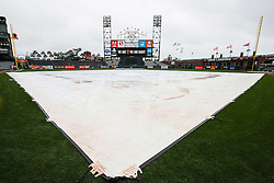 SAN FRANCISCO, CA - APRIL 09:  General view of AT&T Park with the infield tarp during a rain shower before the game between the San Francisco Giants and the Los Angeles Dodgers on April 9, 2016 in San Francisco, California. The Los Angeles Dodgers defeated the San Francisco Giants 3-2 in 10 innings. (Photo by Jason O. Watson/Getty Images) *** Local Caption ***