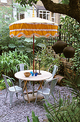 Table and chairs with Sri Lankan monk's ceremonial umbrella. Design: Declan Buckley