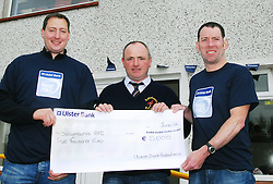 Members of Ballyhaunis RFC teamed up with Ulster Bank making the most of their RugbyForce weekend. The east Mayo Rugby Club were the provincial winners of a support package of ?5000 from Ulster Bank which will be used to improve the club's facilities. Pictured is Tony Henry President Ballyhaunis RFC recieving a cheque for ?5000 from  John Dempsey and Ray Walsh from Ulster Bank ...Pic Conor McKeown