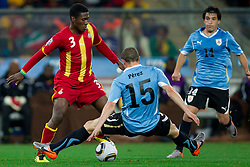 Asamoah Gyan of Ghana vs Diego Perez of Uruguay and Nicolas Lodeiro of Uruguay during to the 2010 FIFA World Cup South Africa Quarter Finals football match between Uruguay and Ghana on July 02, 2010 at Soccer City Stadium in Sowetto, suburb of Johannesburg. (Photo by Vid Ponikvar / Sportida)