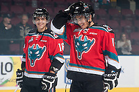 KELOWNA, CANADA - OCTOBER 7: Kris Schmidli #16 and Nick Merkley #10 of Kelowna Rockets share a laugh as they line up against the Swift Current Broncos on October 7, 2014 at Prospera Place in Kelowna, British Columbia, Canada.  (Photo by Marissa Baecker/Getty Images)  *** Local Caption *** Kris Schmidli; Nick Merkley;