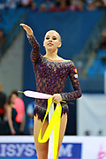 "Kudryavtseva Yana of Russia during final at ribbon in Pesaro World Cup at Adriatic Arena on April 12, 2015, Italy. Yana ""The Queen"" is a Russian gymnast born in Moscow on September 30, 1997. Until her retirement in 2017 was one of atllete most awarded in the history of rhythmic gymnastics."