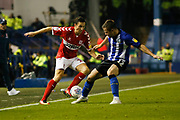 Middlesbrough midfielder Stewart Downing (19) is tackled by Sheffield Wednesday defender Jordan Thorniley (12)  during the EFL Sky Bet Championship match between Sheffield Wednesday and Middlesbrough at Hillsborough, Sheffield, England on 19 October 2018.