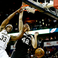 Mar 3, 2017; New Orleans, LA, USA; New Orleans Pelicans forward Dante Cunningham (33) dunks over San Antonio Spurs forward Davis Bertans (42) during the second quarter of a game at the Smoothie King Center. Mandatory Credit: Derick E. Hingle-USA TODAY Sports
