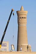 Uzbekistan, Bukhara. Renovation works at Kalon Ensemble.