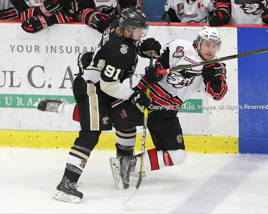 GEORGETOWN, ON  - APR 13,  2017: Ontario Junior Hockey League, Championship Series. Georgetown Raiders vs the Trenton Golden Hawks in Game 1 of the Buckland Cup Final. Mac Lewis #91 of the Trenton Golden Hawks makes the hit on Keegan Blasby #11 of the Georgetown Raiders during the third period.<br /> (Photo by Tim Bates / OJHL Images)