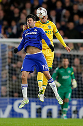 Diego Costa of Chelsea and Jonathan Silva of Sporting compete in the air - Photo mandatory by-line: Rogan Thomson/JMP - 07966 386802 - 10/12/2014 - SPORT - FOOTBALL - London, England - Stamford Bridge - Sporting Clube de Portugal - UEFA Champions League Group G.