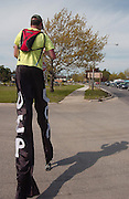 25 year old Neil Sauter walks toward downtown Charlevoix during his frek on stilts across Michigan to raise money and awarness for Cerebral Palsy.  Suater is walking from Toledo, Ohio to Ironwood, Michigan and hopes to raise $10,000.00.