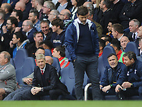 Football - 2016 / 2017 Premier League - Tottenham Hotspur vs. Arsenal<br /> <br /> Arsenal Manager Arsene Wenger glances over at Tottenham Manager Mauricio Pochettino at White Hart Lane.<br /> <br /> COLORSPORT/ANDREW COWIE