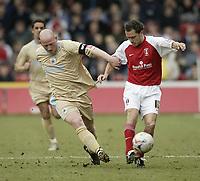 Photo: Aidan Ellis.<br /> Rotherham United v Bristol City. Coca Cola League 1. 25/03/2006.<br /> City's Steve Brooker battles with Rotherham's Paul Hurst