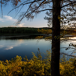 The sun and its reflection in Page Pond in Meredith, New Hampshire.