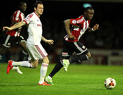 Brentford's Toumani Diagouraga skips past Middlesbrough's Lee Tomlin - Photo mandatory by-line: Robbie Stephenson/JMP - Mobile: 07966 386802 - 08/05/2015 - SPORT - Football - Brentford - Griffin Park - Brentford v Middlesbrough - Sky Bet Championship