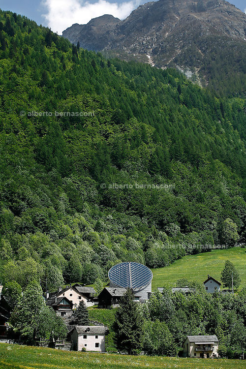 Svizzera, Val Maggia, Moggio, chiesa realizzata dall'architetto ticinese Mario BOTTA......Switzerland,  Canton Ticino: Maggia valley, church designed by Swiss architect Mario Botta Lake Maggiore and its valleys are alpine landscapes that merge into typically Mediterranean scenery, where popular traditions are combined with internationally renowned events, and villages, in which time seems to have stood still, peep down from their lofty peaks on towns that are looking to the future. Fascinating contrasts that make this a unique region