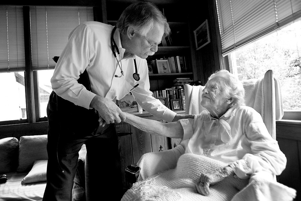 "Dr. Dale Hamrick greets Bea Geiger and prepares to perform a routine checkup on the 97-year-old inside her Columbia home. ""You know if you keep growing I'm going to have to put a new roof on this house,"" she jokes."