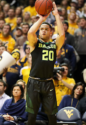 Jan 9, 2018; Morgantown, WV, USA; Baylor Bears guard Manu Lecomte (20) shoots a three pointer during the first half against the West Virginia Mountaineers at WVU Coliseum. Mandatory Credit: Ben Queen-USA TODAY Sports