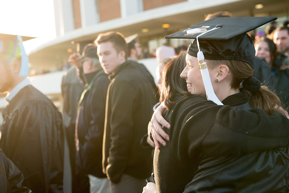 Molly Mcilvain hugs her family following commencement. Photo by Ben Siegel