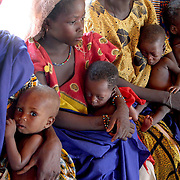 August 4, 2005 - Women wait to have their babies weighed and measured to check for malnourishment at a Doctors Without Borders feeding center in Maradi, Niger. Photo by Evelyn Hockstein/Polaris