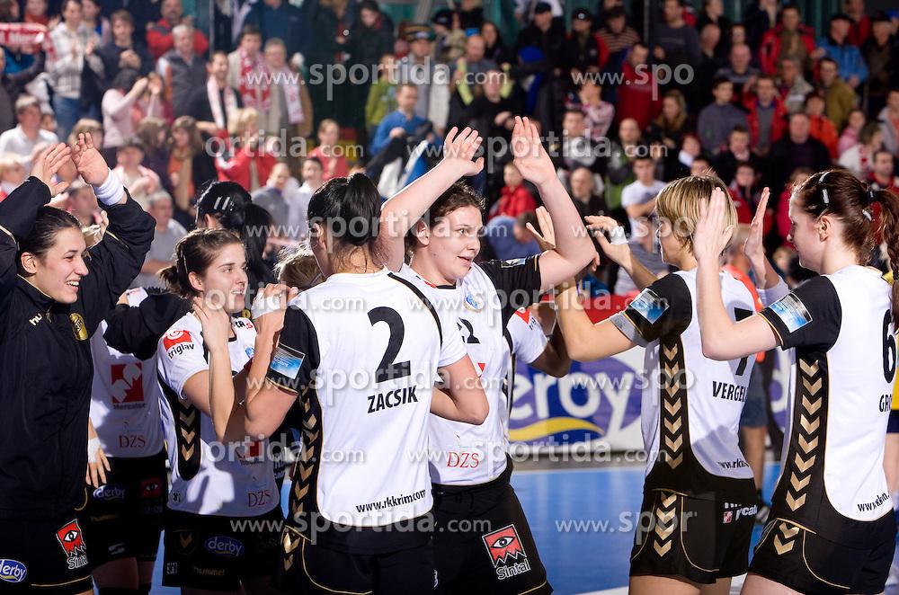 Cvijic Dragana of Krim celebrates with soplayers at handball match of Round 5 of Champions League between RK Krim Mercator and Metz Handball, France, on January 9, 2010 in Kodeljevo, Ljubljana, Slovenia. (Photo by Vid Ponikvar / Sportida)