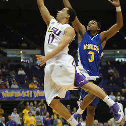 Jan 04, 2010; Baton Rouge, LA, USA; LSU Tigers guard Bo Spencer (11) shoots over McNeese State Cowboys forward Patrick Richard (3) during the first half at the Pete Maravich Assembly Center.  Mandatory Credit: Derick E. Hingle-US PRESSWIRE