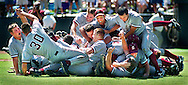The Stanford players pile up on each other after winning the NCAA Baseball Super Regional series played at the Stanford Sunken Diamond..Examiner/Jakub Mosur...June 3, 2000.