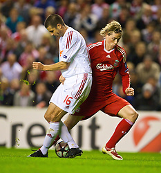 LIVERPOOL, ENGLAND - Wednesday, September 16, 2009: Liverpool's Fernando Torres and Debreceni's Adam Komlosi during the UEFA Champions League Group E match at Anfield. (Photo by David Rawcliffe/Propaganda)