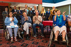 © Licensed to London News Pictures. 19/05/2019. Frimley, UK. Leader of The Brexit Party Nigel Farage (second row, third from right) stands among supporters and MEP candidates at the start of a Brexit Party rally in Frimley, Surrey. Photo credit: Rob Pinney/LNP