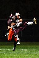 October 9, 2009:  Derrek Allgier of Genoa (24) catches a pass over Vincent Kirsch of Gibsonburg (7) during the High School football game between Gibsonburg Bears and Genoa Comets at Genoa Stadium in Genoa, Ohio.