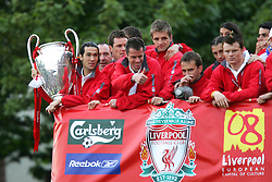 LIVERPOOL, ENGLAND - THURSDAY, MAY 26th, 2005: Liverpool players Luis Garcia, Steve Finnan, JJamie Carragher, and Igor Biscan parade the European Champions Cup on on open-top bus tour of Liverpool in front of 500,000 fans after beating AC Milan in the UEFA Champions League Final at the Ataturk Olympic Stadium, Istanbul. (Pic by David Rawcliffe/Propaganda)