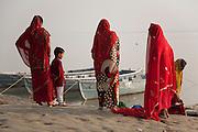 Veiled women on a bank of the Ganges river at Varanasi, Uttar Pradesh, India