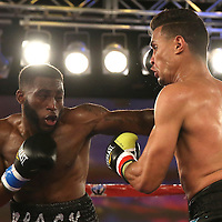 Alphonso Black  (L)  and Daniel Rosario square off during a Telemundo Boxeo boxing match at the A La Carte Pavilion on Friday,  March 13, 2015 in Tampa, Florida. Rosario won the bout by TKO.  (AP Photo/Alex Menendez)