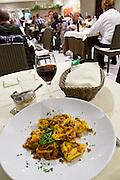 San Lazzaro di Savena (near Bologna). Villa Valfiore. Restaurant Valfiore.<br /> Tortelloni di zucca gialla con ragù rosso di salsiccia (Tortelloni with pumpkin filling and sausage ragout).