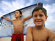 Brothers on beach, Eilat, Israel. Photography by Debbie Zimelman, Modiin, Israel