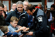 AFC Bournemouth midfielder Marc Pugh signing autographs outside the Vitality Stadium before The FA Cup match between Bournemouth and Everton at the Goldsands Stadium, Bournemouth, England on 20 February 2016. Photo by Graham Hunt.