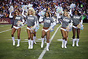A group of Washington Redskins cheerleaders do a dance routine during the Washington Redskins 2015 week 13 regular season NFL football game against the Dallas Cowboys on Monday, Dec. 7, 2015 in Landover, Md. The Cowboys won the game 19-16. (©Paul Anthony Spinelli)