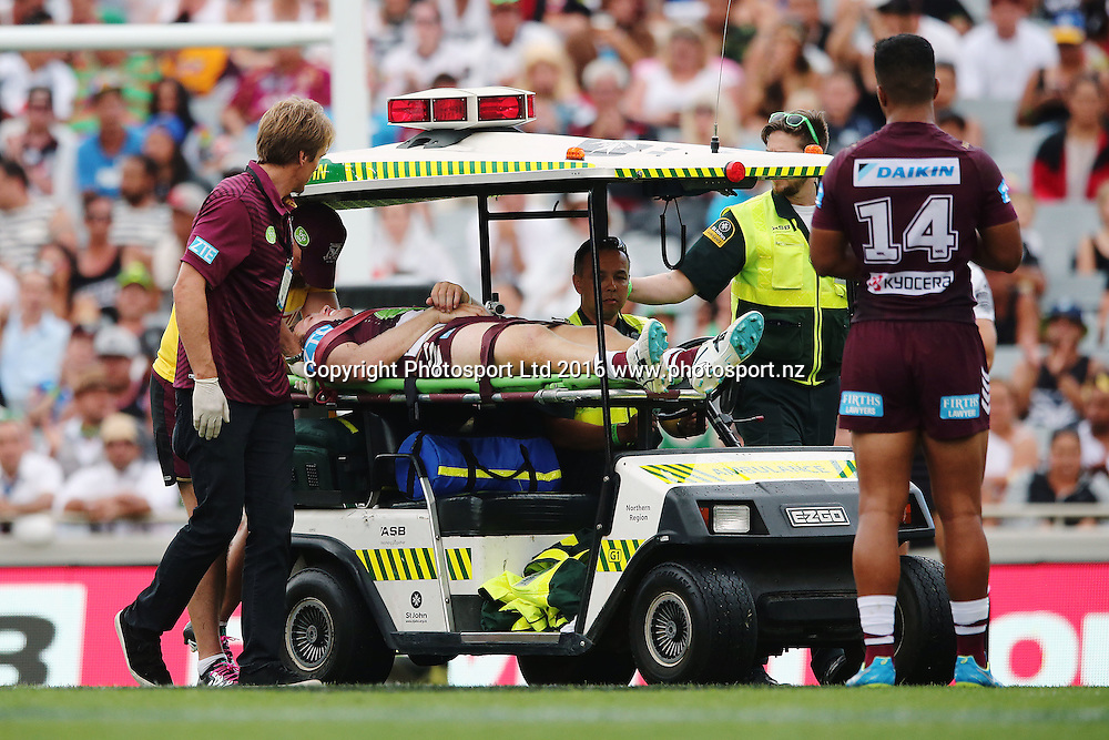 Jake Trbojevic of the Sea Eagles is carried off the field after taking a big hit from Konrad Hurrell of the Warriors during Day 1 of the NRL Auckland Nines Rugby League Tournament, Eden Park, Auckland, New Zealand. Saturday 6 February 2016. Photo: Anthony Au-Yeung / www.photosport.nz