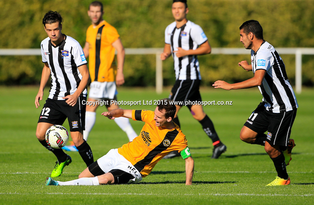 Wellington's Cole Peverley tackles Saul Halpin. Hawkes Bay United v Wellinton, Semi final leg 1, ASB Premiership football, Park Island, Napier, New Zealand. Saturday, 21 March, 2015. Copyright photo: John Cowpland / www.photosport.co.nz