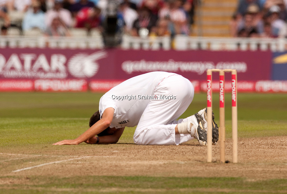 Bowler Steven Finn falls over whilst bowling and injures his ankle during the second npower Test Match between England and Pakistan at Edgbaston, Birmingham.  Photo: Graham Morris (Tel: +44(0)20 8969 4192 Email: sales@cricketpix.com) 08/08/10