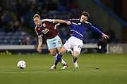 Scott Arfield of Burnley and  Tom Lawrence of Cardiff City battle for the ball during the Sky Bet Championship match between Burnley and Cardiff City at Turf Moor, Burnley, England on 5 April 2016. Photo by Simon Brady.