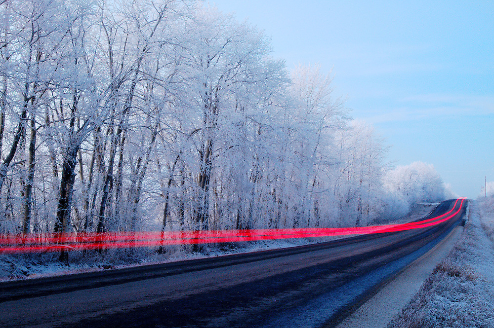 Tail lights from a car can be seen in this long-exposure near Edmonton, Alberta on January 2, 2006.