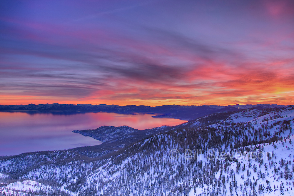 a HDR tonemapped colorful winter sunset over lake tahoe california and snowy sierra nevada mountains