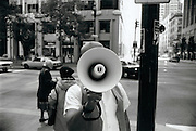 Portrait of bullhorn evangelist on Market Street in San Francisco.