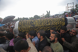 June 15, 2018 - Baramulla, Jammu and Kashmir, India - Mourners carry the coffin containing the body of senior journalist and editor of Rising Kashmir newspaper Shujaat Bukhari in Kreeri area of north Kashmir's Baramulla some 40 kilometeres from Srinagar the summer capital of Indian controlled Kashmir on June 15, 2018. Shujaat was shot dead along with his two personal security guards by unknown gunmen on Thursday evening on June 14  in press colony Srinagar. (Credit Image: © Faisal Khan via ZUMA Wire)