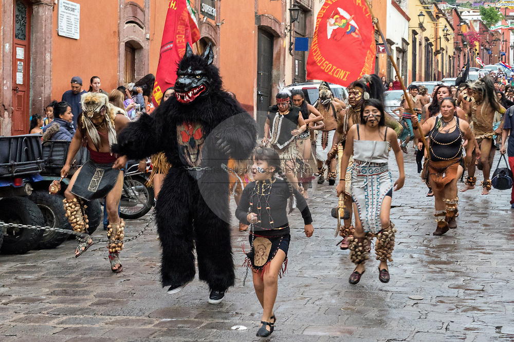 A costumed wolf dances in a procession through the historic city during the week long fiesta of the patron saint Saint Michael September 24, 2017 in San Miguel de Allende, Mexico.