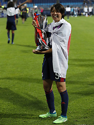 Saki Kumagai of Olympique Lyonnais with UEFA Womens Champions League trophy during the UEFA Women's Champions League final match between VfL Wolfsburg women and Olympique Lyonnais women on May 24, 2018 at  Valeriy Lobanovskiy Dynamo Stadium in Kyiv, Ukraine