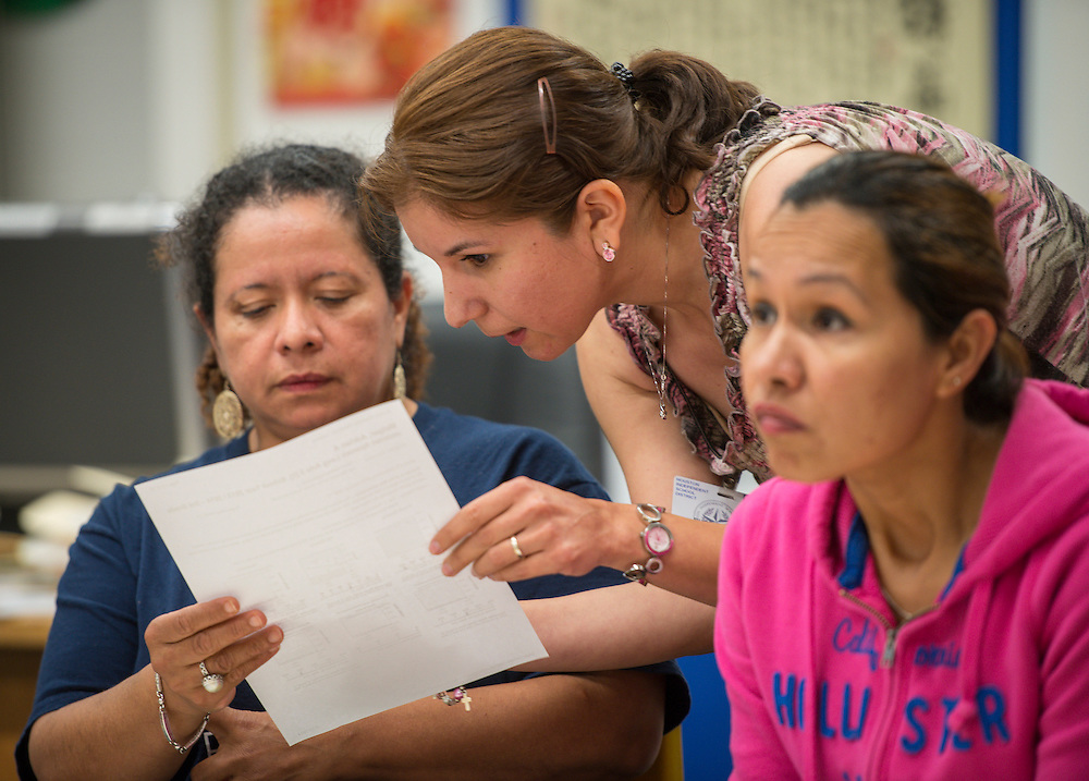 Teachers work with parents of third graders during an Academic Parent Teacher Team (APTT) session at Durham Elementary School, May 13, 2014.